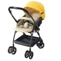 xe đẩy du lịch cho bé thương hiệu aprica màu vàng